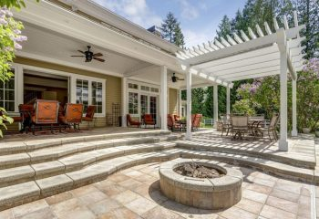 lovely-outdoor-deck-patio-space-with-white-dining-pergola--1007311218-c93890a8c8584c428b74280687bab766